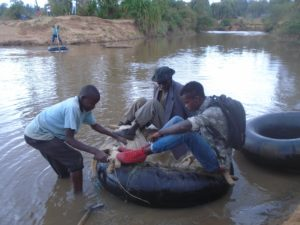 Residents ready to cross river Nzoia on a motor vehicle tyre tube