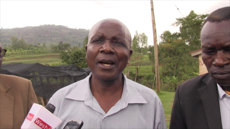 Kikai Coffee Farmers Co-operative Society Manager Patrick Maskini addressing the press