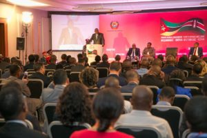President Kenyatta addressing listeners at the business forum in Maputo, Mozambique
