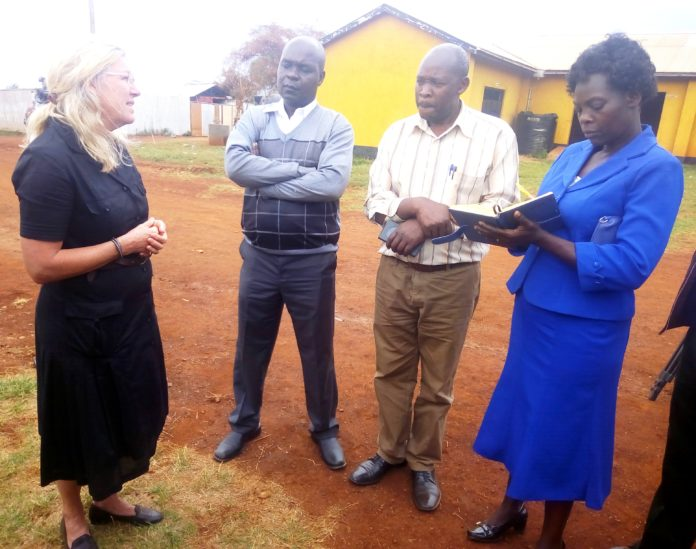 The Trans Nzoia County Vocational Training Director Eliud Lusweti (second right) has urged students to enrol in vocational training centres