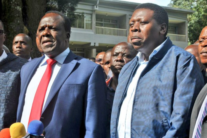 Kakamega Governor Wycliffe Oparanya and Devolution CS Eugene Wamalwa briefing the media about the devolution conference after a preparation meeting