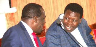 Kakamega Governor Wycliffe Oparanya sharing a word with Devolution CS Eugene Wamalwa during a briefing meeting in preparation for the devolution conference which is underway in Kakamega