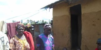 Mrs. Nerea Akosa Kanale (right) with other family members near the door where her son committed suicide