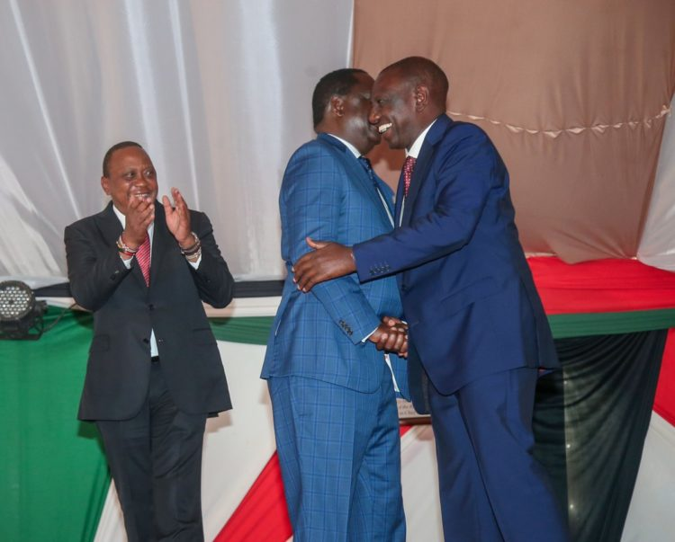 Deputy President William Ruto and Raila Odinga shake hands as President Uhuru Kenyatta keeps a close watch