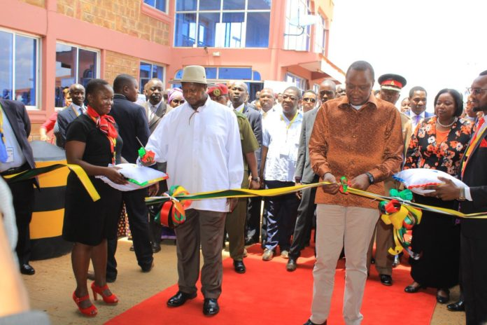 President Uhuru Kenyatta and Uganda President Yoweri Museveni during the opening of the Busia Border Post in February