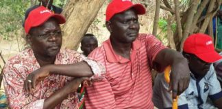 West Pokot Governor John Lonyangapuo (left) and West Pokot Senator Samuel Poghisio (centre)