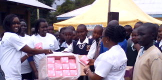 Nandi first lady Sheila Sang, Deputy Governor Dr Yulita Cheruiyot and Health CEC Ruth Koech giving out sanitary towels to school girls at Kugeroniat school in Mosop constituency