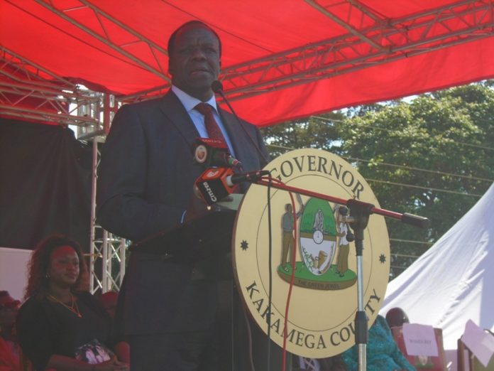 Kakamega County Governor Wycliffe Oparanya addressing residents during 55 Madaraka day celebrations held at Moi Girls Nangili High School in Likuyani