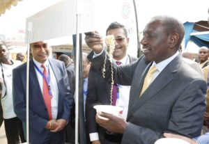 Deputy President Ruto sampling products at the Kenya Trade Week Expo