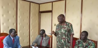 West Pokot Governor John Lonyangapuo (left) meeting security chiefs