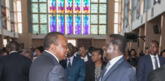 President Uhuru Kenyatta and former premier Raila Odinga at the memorial service at the Holy Family Basilica
