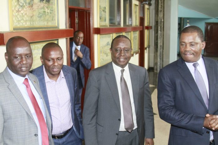 The fuel crisis meeting between the Treasury CS Henry Rotich (centre) and parliament leaders was chaired by Speaker Justin Muturi (right)