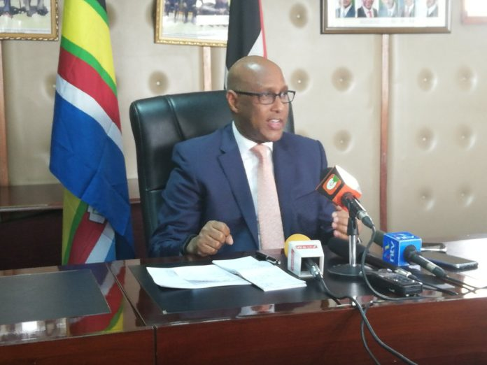 EAC CS Adan Mohamed addressing the press