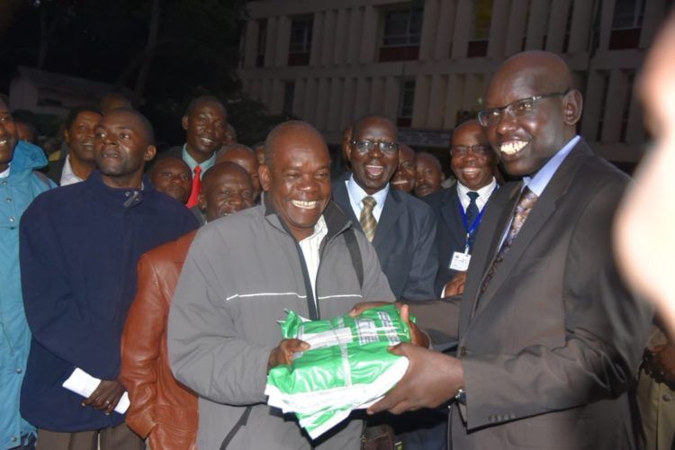 Education PS Belio Kipsang hands over KCPE exam papers in Kakamega