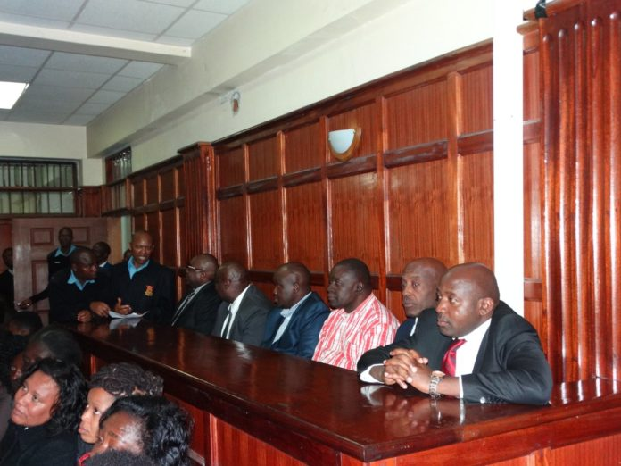 Lugari MP Ayub Savula and former ICT PS Sammy Itemere (first, second top row) in court. (PHOTO/ODPP)