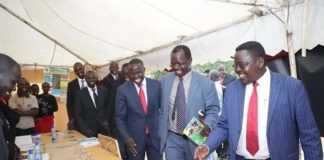 Nandi Governor Stephen Sang and West Pokot Governor John Lonyangapuo (centre) during the West Pokot Agricultural show at Kishaunet