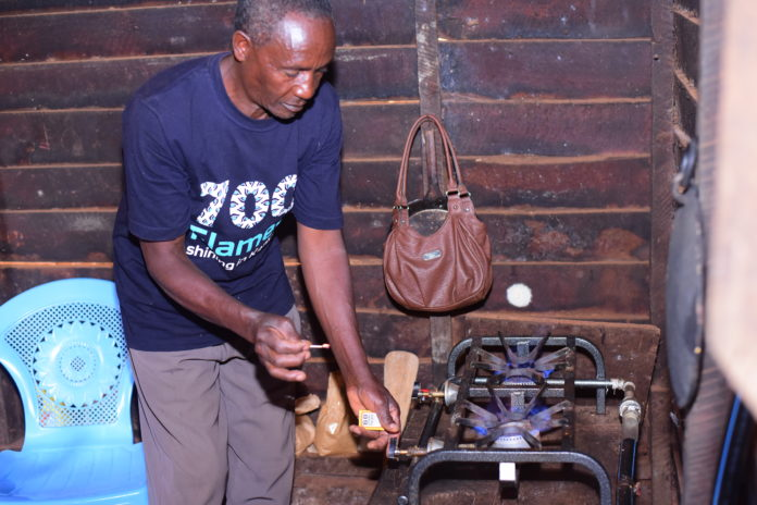 A farmer, George Kariuki using biogas to cook