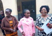 From Right-The school headteacher Esther Matte, the top KCPE candidate in the school Cynthia Musimbi and her guardian Debora Kadurenge