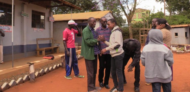 Michael Maisiba of Fountain Grammer academy being congratulated after scoring 440 marks in this year's KCPE