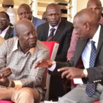 Deputy President William Ruto talking to Trans Nzoia Governor Patrick Khaemba. (PHOTO/DPPS)