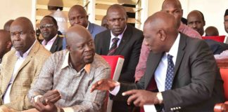 Deputy President William Ruto talking to Trans Nzoia Governor Patrick Khaemba in a past function (PHOTO/DPPS)