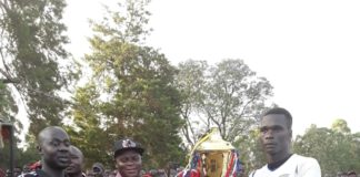 Bungoma Roads CEC Collins Mukhongo (centre left) handing over the trophy