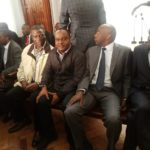 Outgoing KPC MD Joe Sang (right) and other company top officials in court