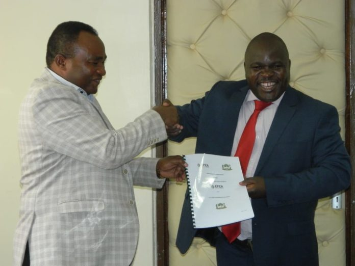 The Trade and Industries CEC Kassim Were (right) with EPZ General Manager-Operations and Investor Support Dr. Meshack Kimeu exchanging the MoU