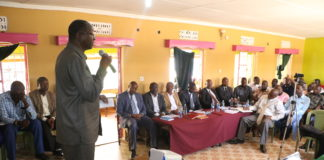 Busia Deputy Governor Moses Mulomi addressing water stakeholders during the handing over of the Kshs 1 billion Malaba Water Supply and Sewerage system to contractors in Malaba