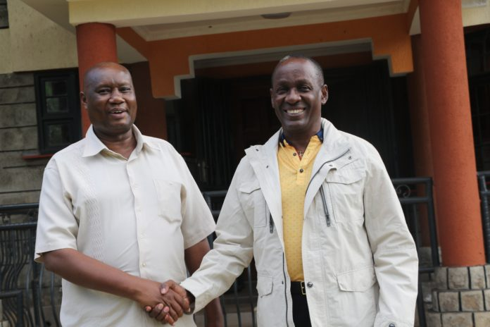Busia Governor Sospeter Ojaamong and Uganda NRM Eastern Region vice chairman Captain Mike Mukula