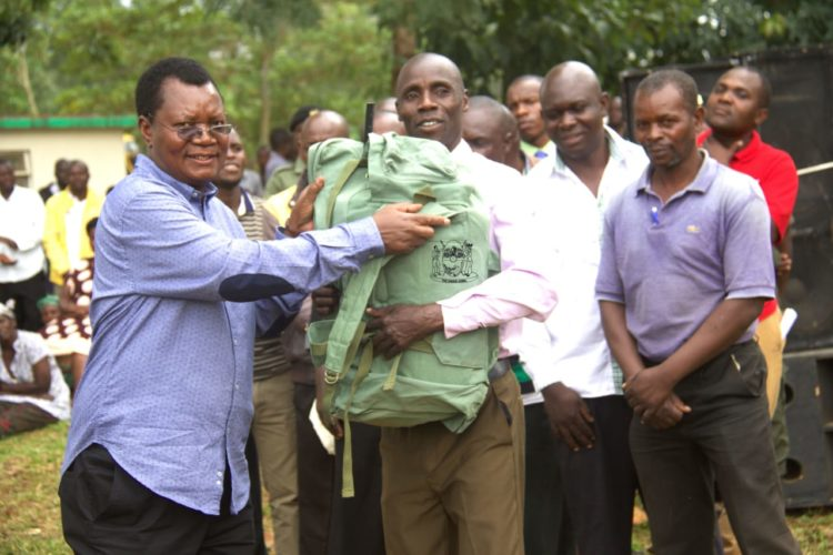 Kakamega Deputy Governor Philip Kutima handing Artificial Insemination(AI) tools to extension officers from the County