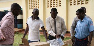 Busia County Chief officer for Health and Sanitation Dr. Isaac Alukwe inspects medical equipment at Matayos Drugs Stores