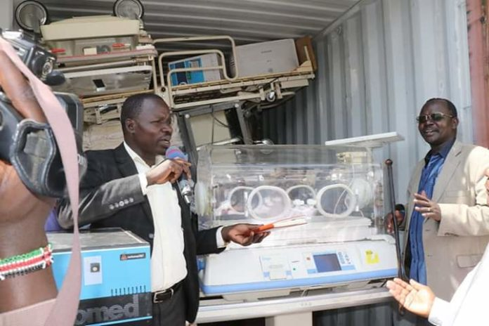 West Pokot Governor John Lonyangapuo receives the medical equipment
