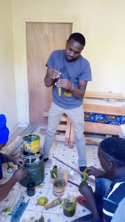 Vitalis making the mosquito repellent candles