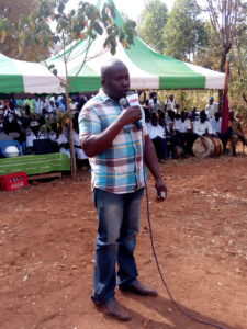 Walter Namisi addressing mourners