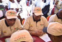 Interior PS Karanja Kibicho (centre) said the mass registration will begin in March