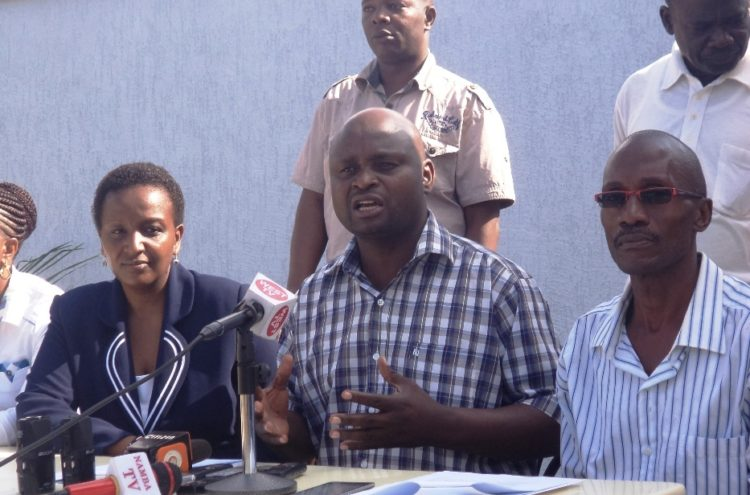 KNUN Secretary General Seth Panyako (centre) and Busia County KNUN Secretary General Isaiah Omondi (right) among other leaders addressing media at a a hotel in Busia town during a past event
