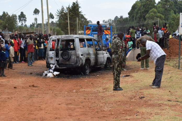 The police vehicle that was burnt after being involved in the accident