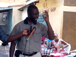 Stephen Oballa speaks during a traders meeting on the issue