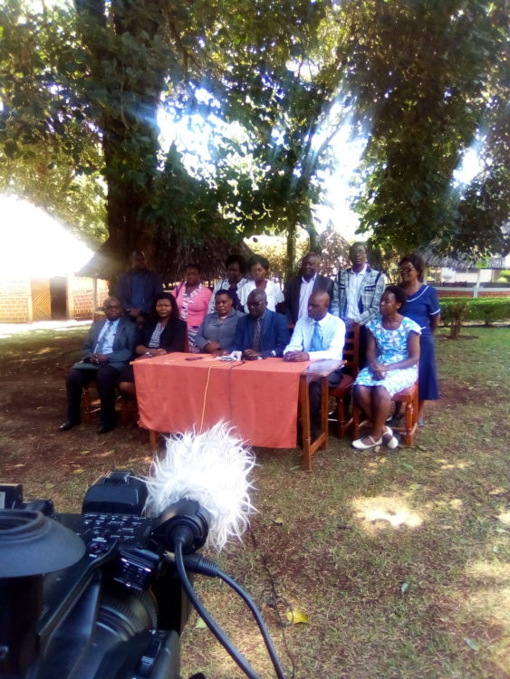 Kakamega County Ministry of Health officials and KNUN officials issuing a statement to the press