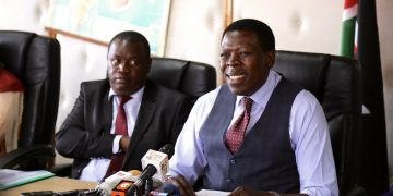 Devolution CS Eugene Wamalwa speaking to the press at his office