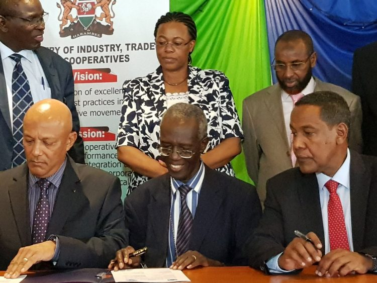 From left: EACC CEO Twalib Mbarak, EACC Chairman Eliud Wabukala and PS State Department for Cooperatives Ali Noor during the signing of the MoU