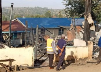 Residents looking at what remained after the fire outbreak