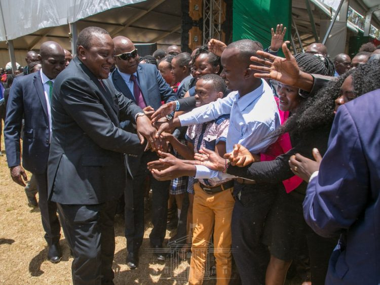 President Kenyatta interacting with youths at State House. Photo/PSCU