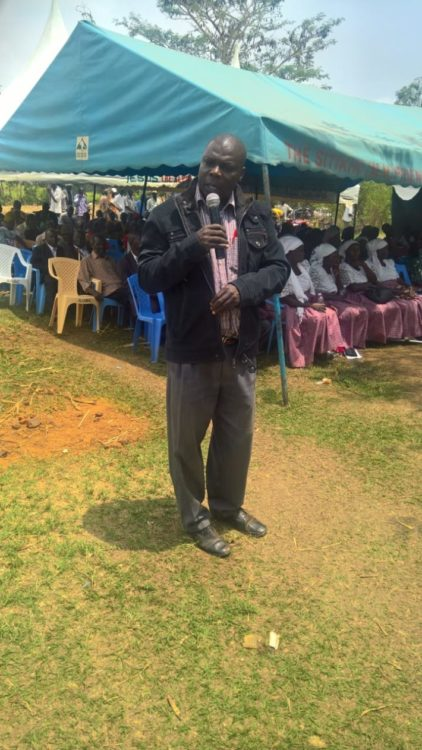 Sitikho primary school headteacher Joseph Oluka addressing mourners in Mwembula