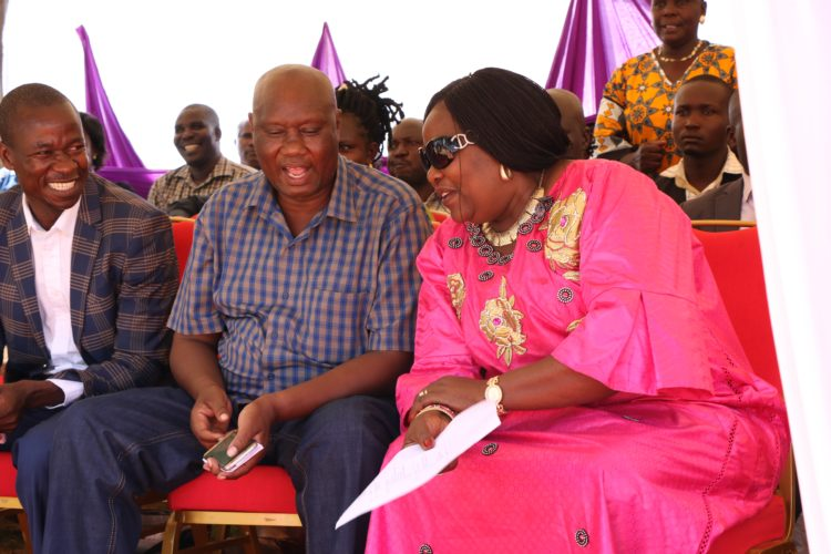 Busia Governor Sospeter Ojaamong and Dr Ida Odinga share a light moment during the International Women's Day celebrations at Angurai DO's compound in Teso North