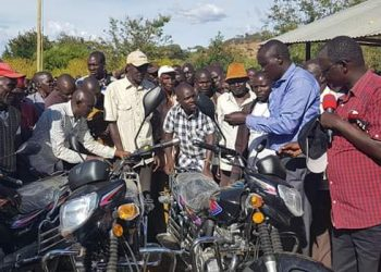 West Pokot Governor John Lonyangapuo handing over the bikes