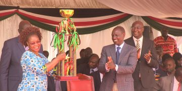 Deputy President William Ruto presenting a trophy at the National Drama and Film Festival