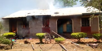 The officer's house that was set ablaze by locals