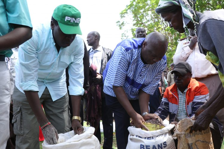 Devolution CS Eugene Wamalwa and Busia governor Sospeter Ojaamong distribute relief food to flood victims of Amoni in Teso North Sub County
